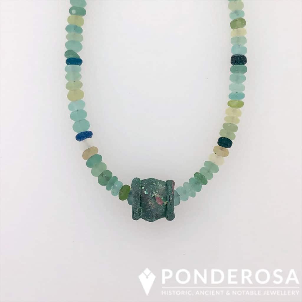 Roman Glass and Bronze Bead