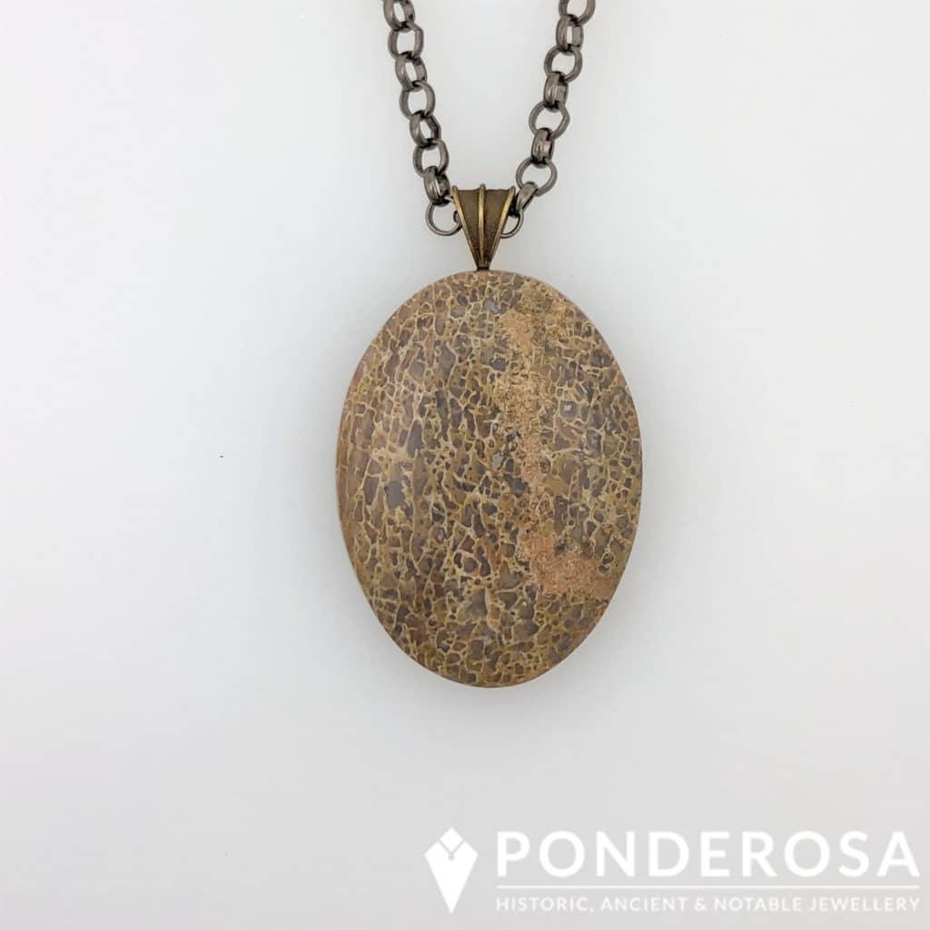 Fossilized Dinosaur Bone Pendant – Brown